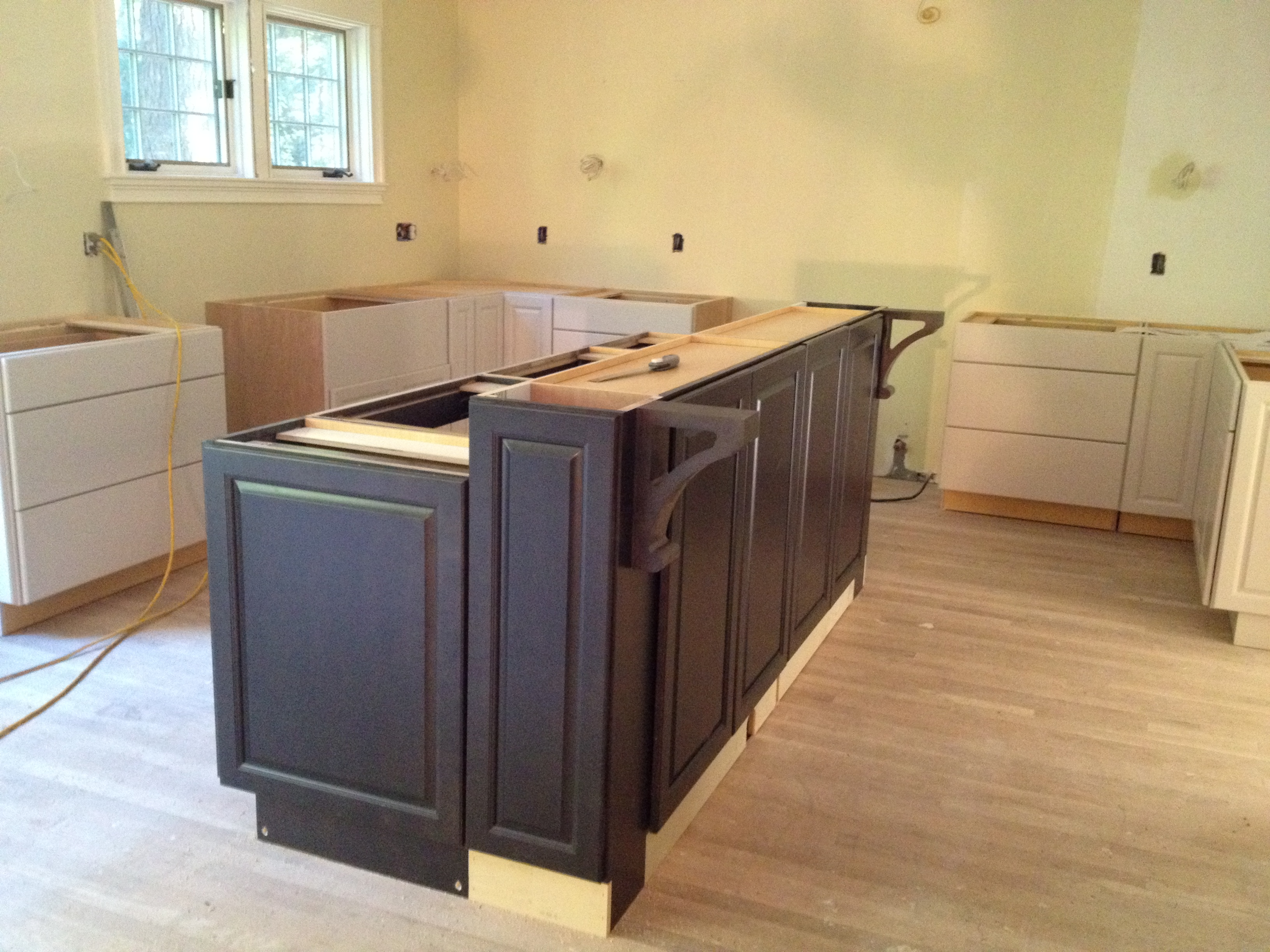 Building a kitchen island with cabinets for Making a kitchen island from cabinets