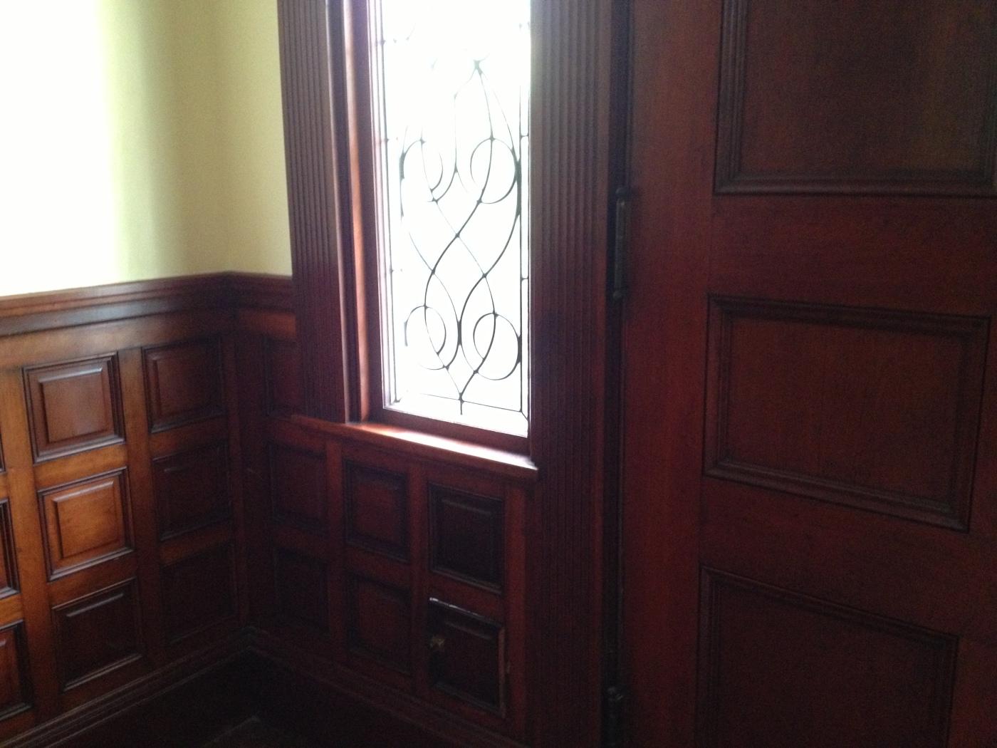Victorian Vestibule with Wood Paneling